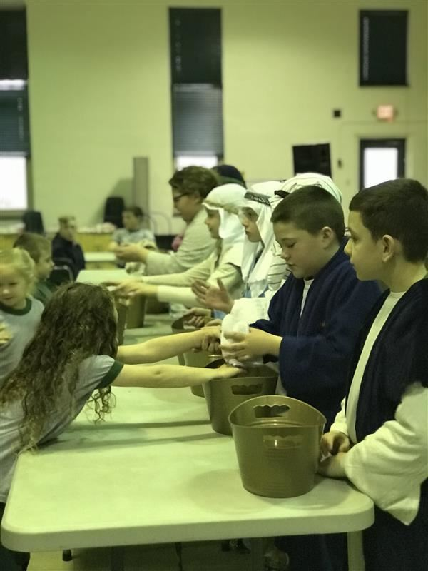 4th and 5th Grade students wash the hands of our school community as Jesus taught his disciples